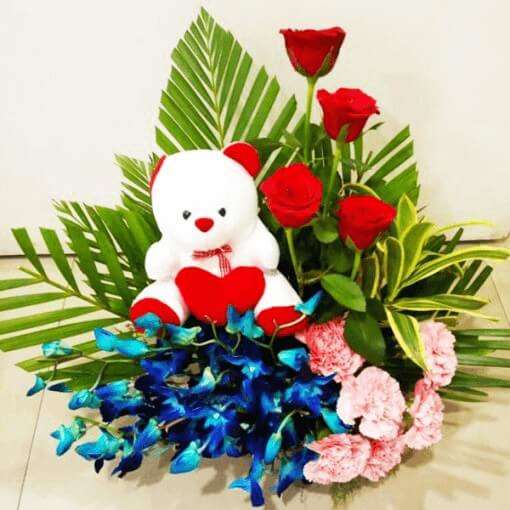 colorful-flowers-lilies-roses-with-teddy-bunch