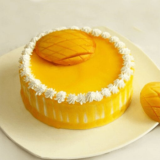 yellow-colour-dainty-round-shape-mago-cake
