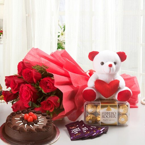 round-chocolate-cake-with-flowers-bouquet-and-teddy-ferrero-rocher
