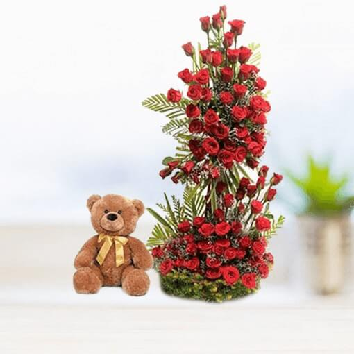 brown-teddy-with-red-flowers-bouquet