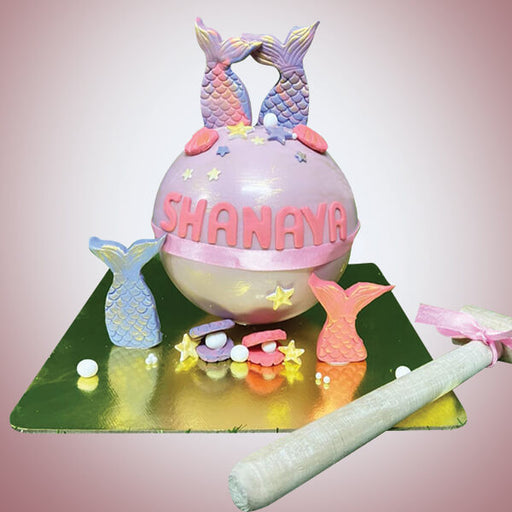 Ball-shape-pinata-cake-with-hammer-with-fish-decoration