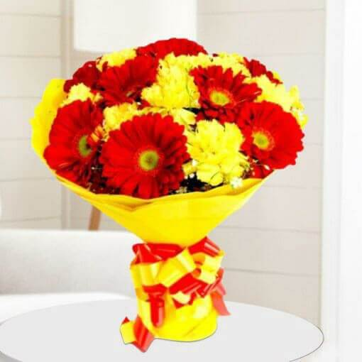 Red and Yellow Flower in Yellow Wrap