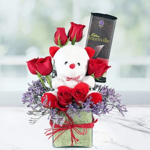 Vase of Roses with Teddy Bear