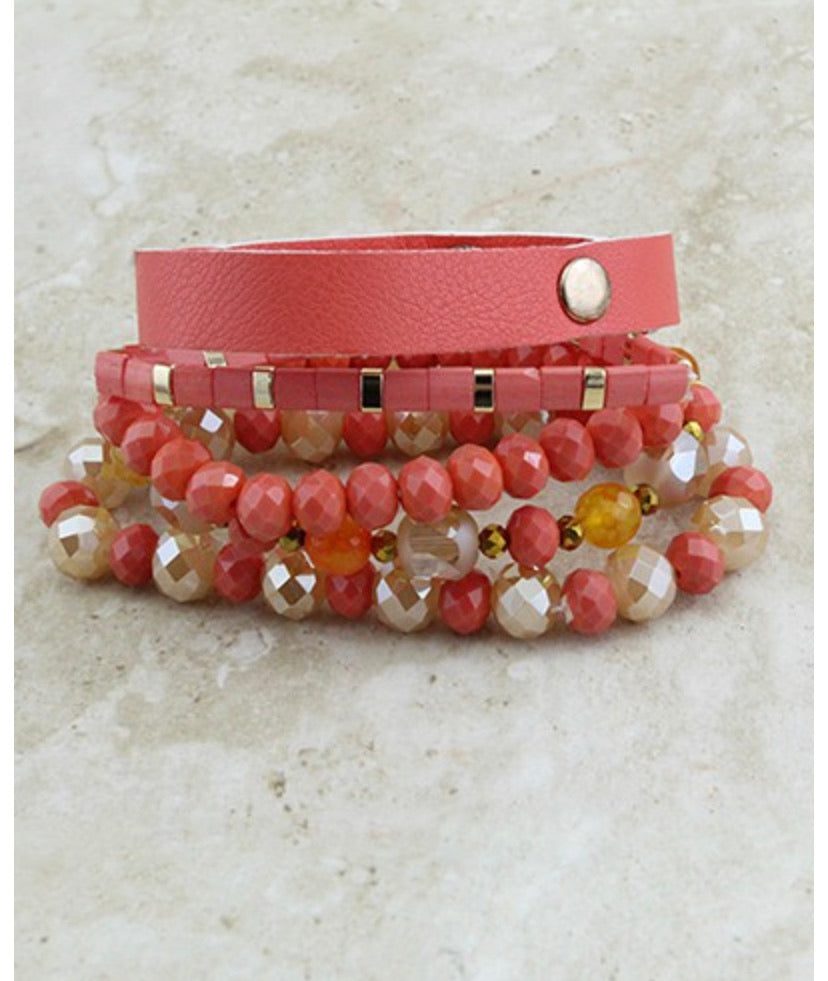 Coral colored stacked bracelets with Faux leather bracelet with snap
