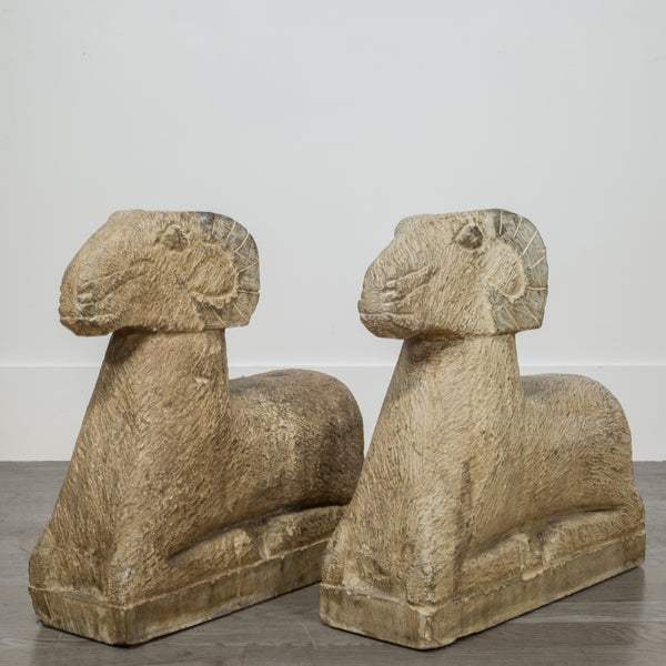 Pair of Art Deco Style Carved Sandstone Reclining Rams, 20th c.