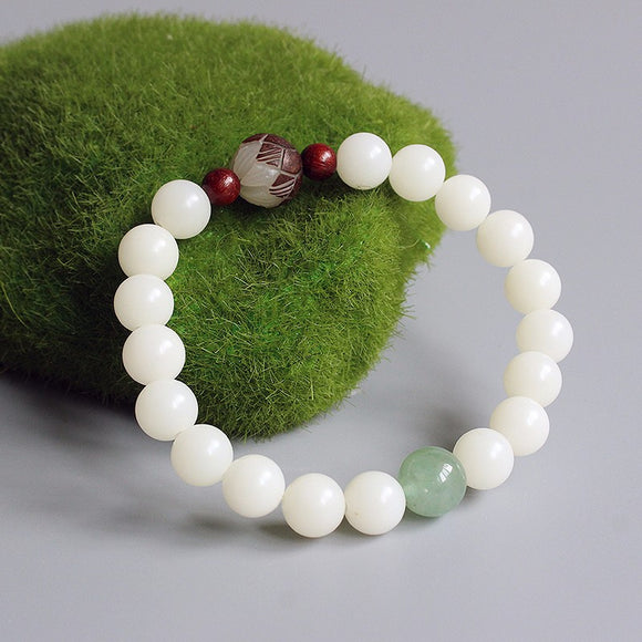 White bodhi seed bracelet with carved flower and jade accents