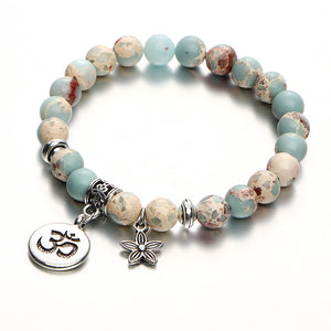Beaded Ohm Bracelet with star charm - angled with shadow