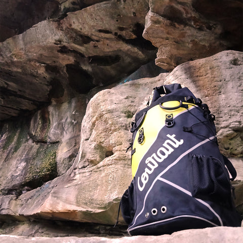 Courant Dock Bag in Flash Lemon holding a 70m rope, and a full rack of rock climbing gear.