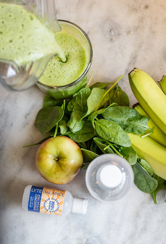 Smoothie, apple, spinach, banana, electrolyte, vitamix, green, marble counter, white kitchen