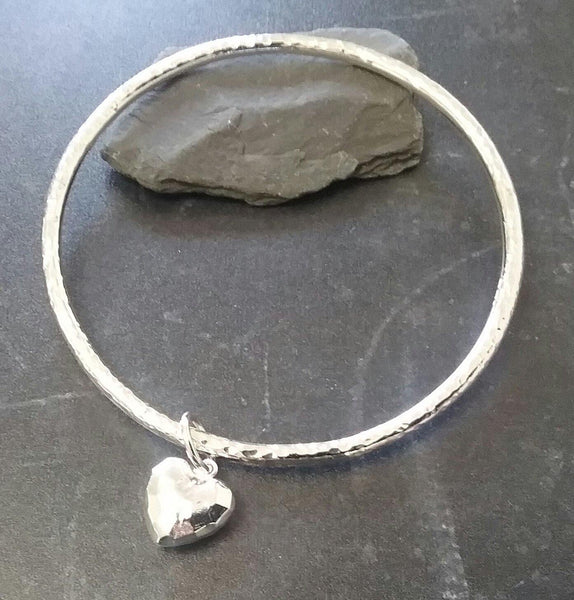 Hammered heart sterling silver bangle