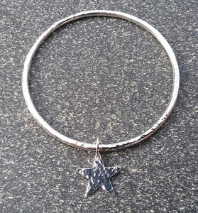 Slim hammered star sterling silver bangle