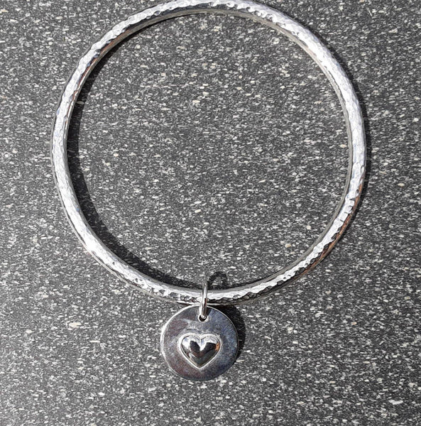 Chunky hammered sterling silver bangle with heart charm