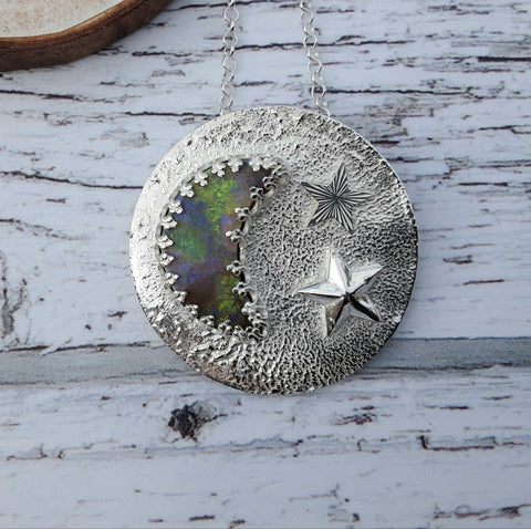 Cultured opal and sterling silver moon and stars pendant.