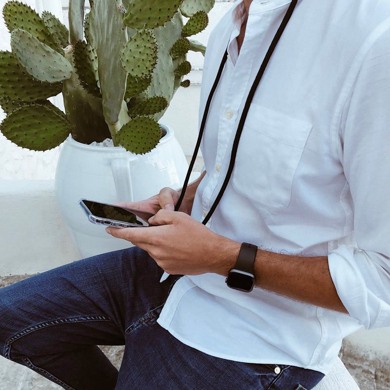 Instagram blogger wearing the classic Midnight Black Phone Necklaces from Berlinbondi in the street of Ostuni Puglia