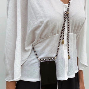 Female model closed up wearing Neni Phone Necklace from Berlinbondi in Berlin