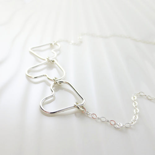Kaia triple heart necklace