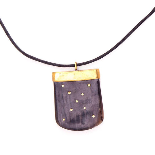 Horn and brass pendant on waxed cord