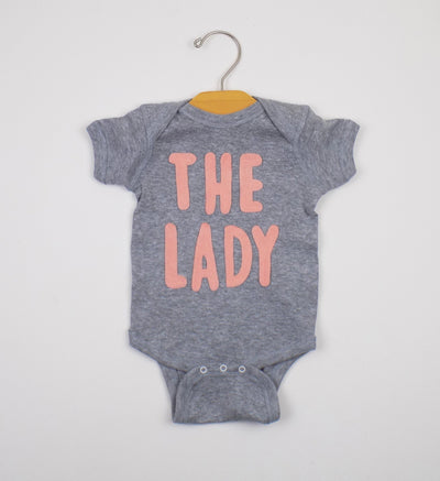 The Lady baby bodysuit