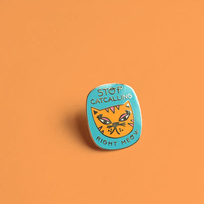 """Stop Catcalling"" orange enamel pin"