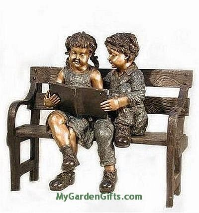 Reading Boy and Girl on a Bench Sculpture