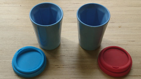 A pair of blue Therma cups
