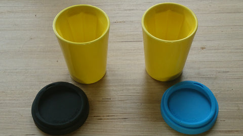 A pair of yellow Therma cups