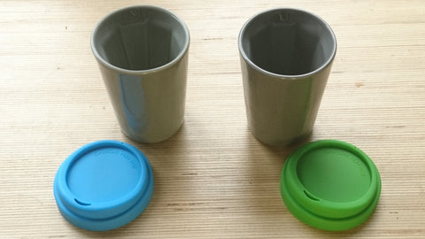 A pair of grey Therma cups