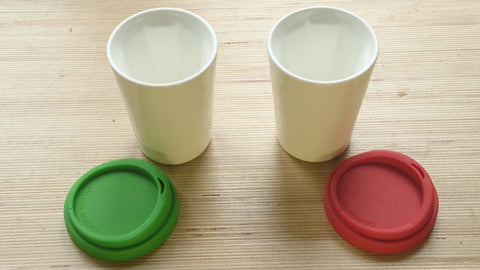 A pair of white Therma cups