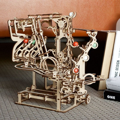 Wooden Marble run chain hoist model kit with books in the background