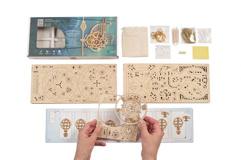Showing all package contents including parts and tools for wooden clock model kit