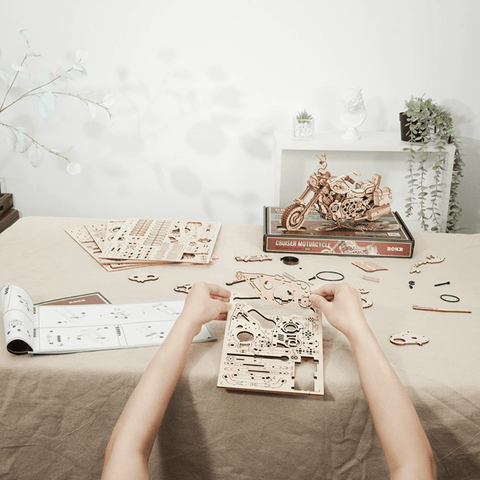 wooden mechanical cruiser on the table being assembled