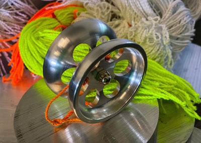 "Fully machined 2.5"" billet aluminum Yo-Yo. Custom grooved 10 ball bearing for sleeping. Response pads for quick return. Machined holes cutting the air as the Yo-Yo is in full motion, also allowing the billet machined cuts to drop weight for highest performance. Stainless steel cap nuts. Machined finish. MADE IN THE USA."