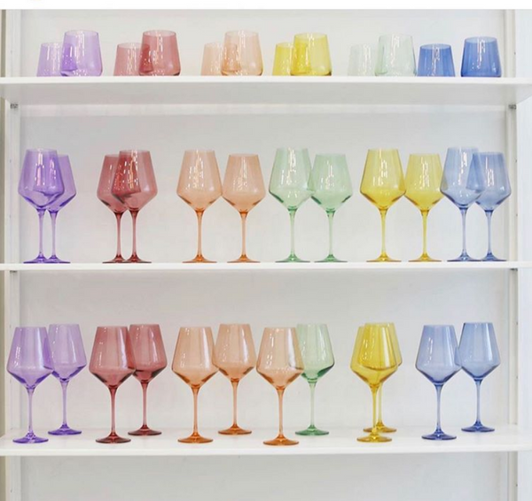Instagram post of rainbow colored wine glasses by Estelle Colored Glass