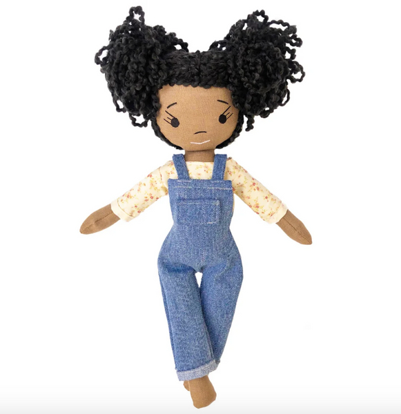 HarperIman Doll wearing blue jean overalls and white shirt against a white background