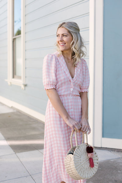 Katie Dean, founder of Katie Dean Jewelry in a pink gingham dress from Reformation, perfectly pink for the Galentine's Brunch hosted by Sarah Tripp of Sassy Red Lipstick at Le Marais Bakery in San Francisco