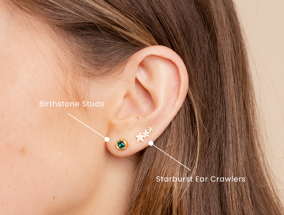 Earring Party 101, how to stack up dainty gold earrings like a pro, featuring the Birthstone Stud Earring and the Starburst Ear Crawlers Katie Dean Jewelry made in America