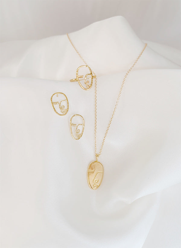 Artist Face Collection, dainty ring and earrings, wire framing of a face and pendant made by Katie Dean Jewelry