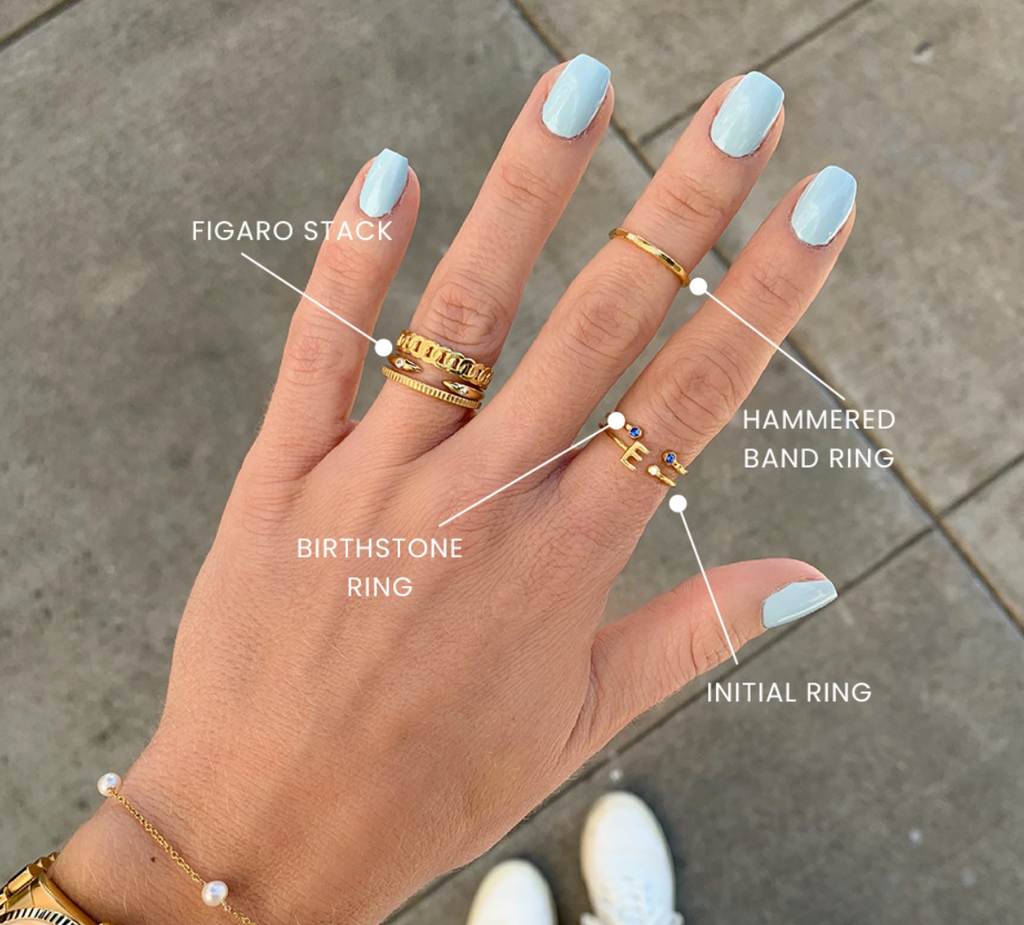 Baby blue nails and gold stacking rings handmade in America by Katie Dean Jewelry