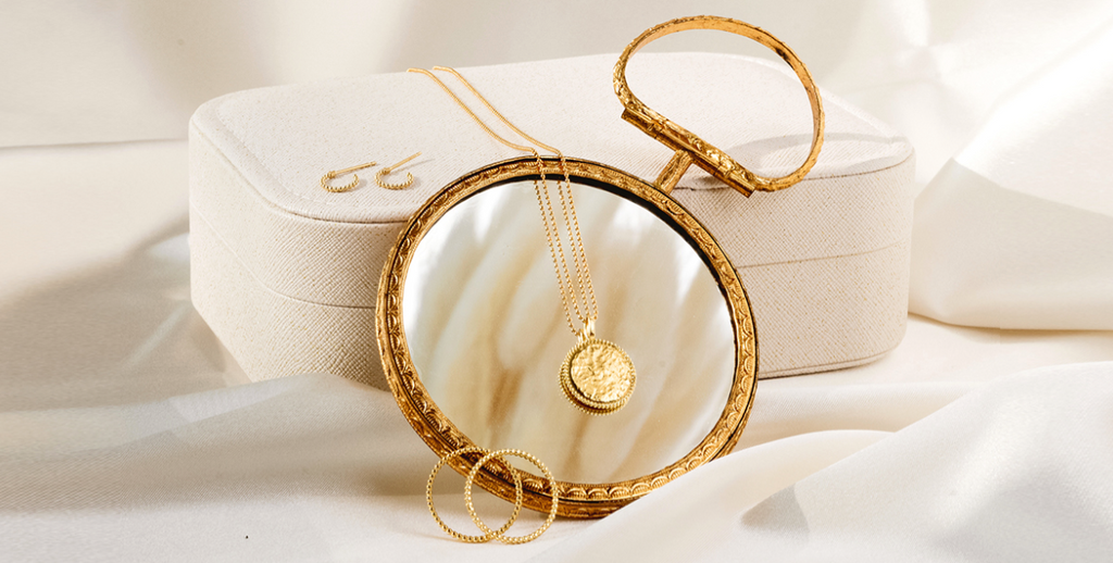 Beaded Collection as shown with a little round mirror and a white jewelry case Katie Dean Jewelry