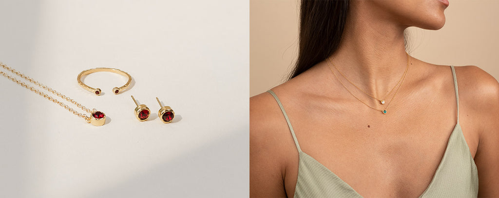 Birthstone Collection as seen in a split image banner, the left side shows the Birthstone ring, necklace and earrings on a white background and the right side of the image shows the upper body of a model wearing two dainty gold birthstone necklaces.