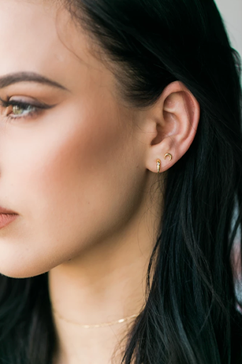 Katie Dean Jewelry model wearing Claw Studs with Moon Studs.