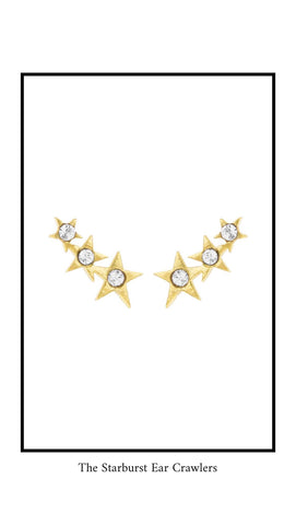 Starburst Ear Crawlers in gold. Each stud has three little stars on it with a white Swarovski Stone in the middle of each star.