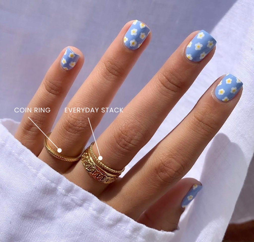 Floral nails and gold stacking rings handmade in America by Katie Dean Jewelry