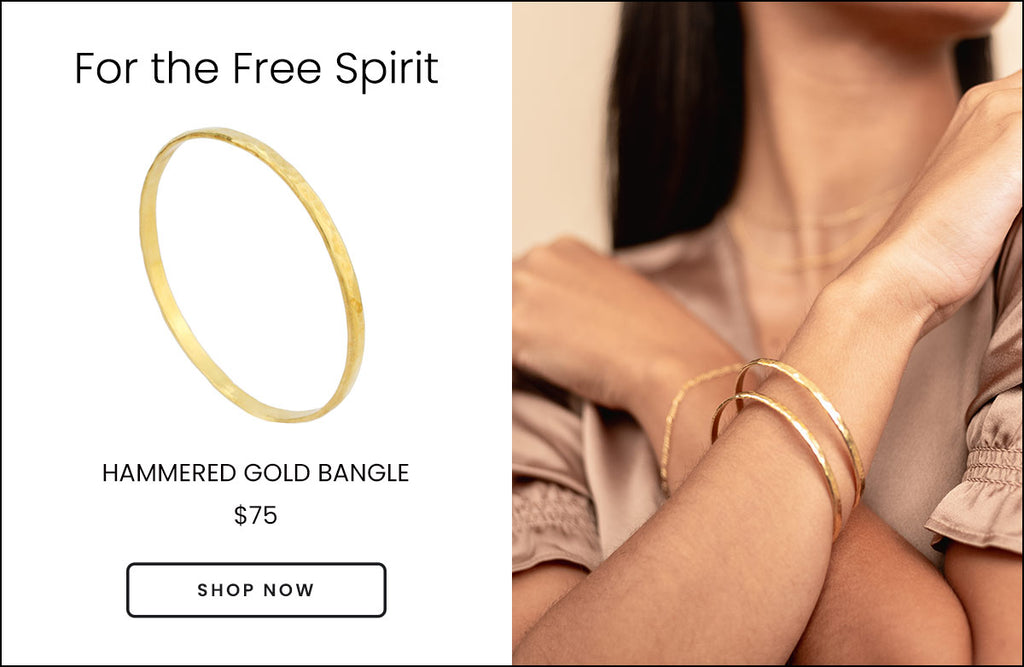 Gold Hammered Bangle by Katie Dean Jewelry shown on a model wearing two bangles with a brown silk top