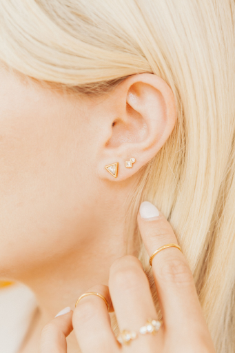 Katie Dean wearing Geo Mini Studs + Triangle Studs.