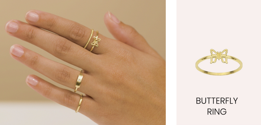 Hand Model wearing the Dainty gold Butterfly Ring by Katie Dean Jewelry