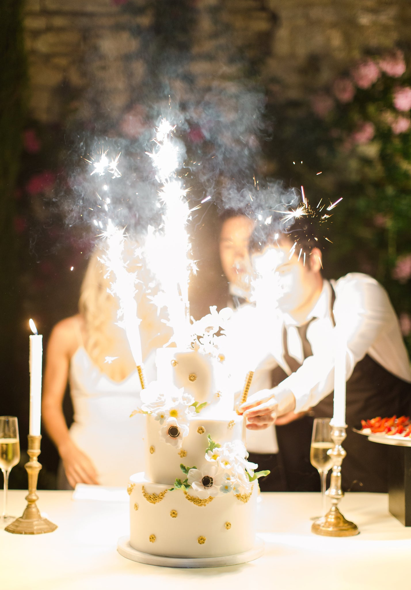 Katie Dean Jewelry romantic destination wedding at a chateau, Provence, France, cake sparklers