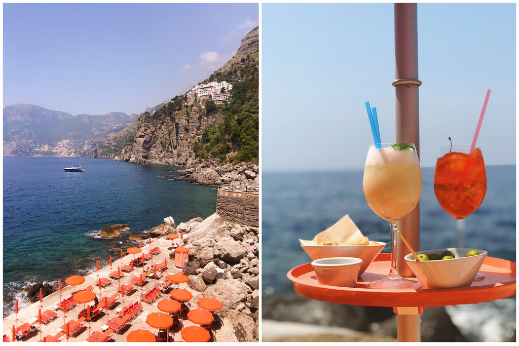 Two photos side by side, on the left a picture of orange umbrellas lined up in a row on One Fire Beach and on the right, two cocktails side by side with the water in the background.
