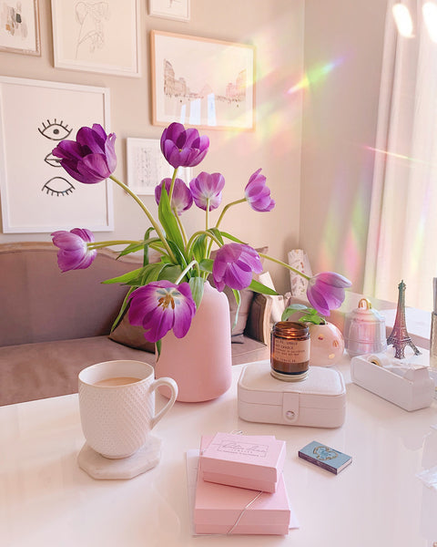 Purple tulips in a pink vase on Katie Dean Jewelry's Desk, The Power of Flowers blog