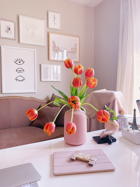 Orange red tulips in a pink vase on Katie Dean Jewelry's Desk, The Power of Flowers blog